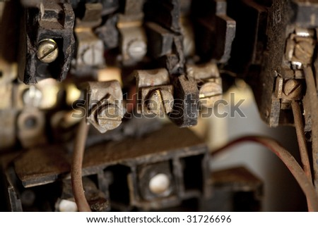 Horizontal image of an old ruined fuse box in a derelict warehouse.