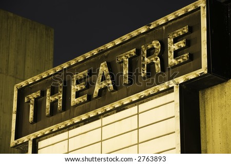 Horizontal image of an old Theatre Marquee.  Evening shot. - stock photo