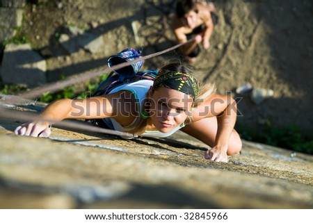 Horizontal image of climber climbing up the wall - stock photo