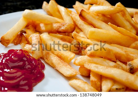Horizontal image of french fries with ketchup - stock photo