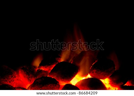Horizontal image of hot charcoal fire ready for barbecue with black copy-space - stock photo