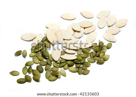 Horizontal image of pumpkin seed isolated on white background - stock photo