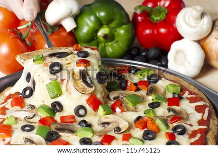Horizontal image of supreme pizza with ingredients on the background - stock photo
