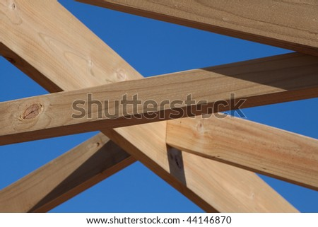 Horizontal image of timber roof frame under construction - stock photo