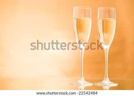 Horizontal image of two champagne standing on the table - stock photo