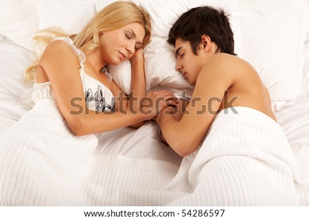 Horizontal image of young couple sleeping at night