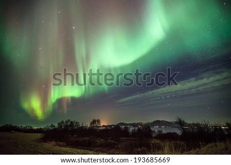 horizontal landscape of auroa boealis in norway - stock photo