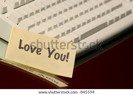 horizontal love you message on the keyboard - stock photo