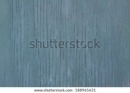 horizontal orientation close up of a vintage, aged, wooden panel painted in porcelain blue paint, with copy space / Vintage Porcelain Blue painted wood - stock photo