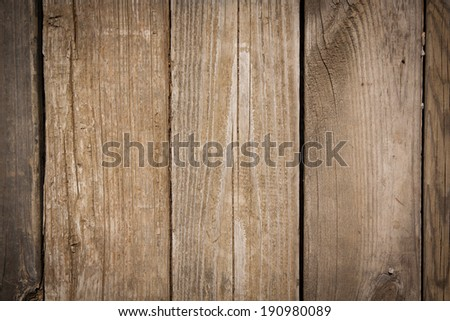 horizontal orientation close up of weathered wooden boards in a warm finish, as a background or texture, with copy space / Horizontal wooden boards - stock photo
