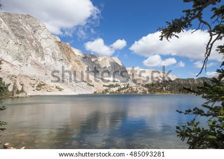 horizontal orientation color image of Mirror Lake in Wyoming, USA with surrounding mountains / Mirror Lake in Wyoming, USA