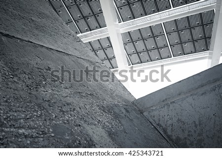 Horizontal Photo Modern Solar Panel with Blank Dark Concrete Blocks. Contemporary Building Architecture. Empty Abstract background - stock photo