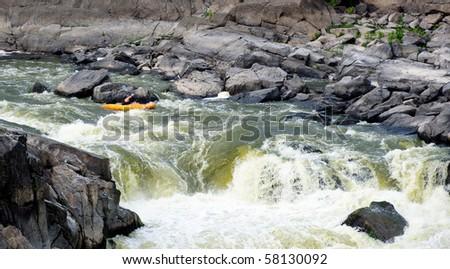 Horizontal photo of kayaker running Potomac river rapids - stock photo