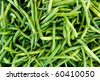 Horizontal photo of pile of just harvested green beans at farm market - stock photo