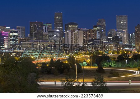 Horizontal photo of the Denver skyline at dusk.