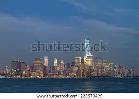 Horizontal Photo of the Freedom Tower with New York City skyline. - stock photo