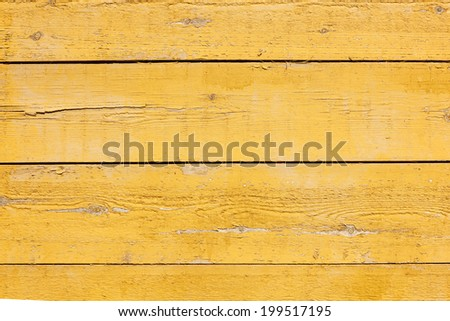 horizontal picture of old horizontal planks with bright yellow paint - stock photo