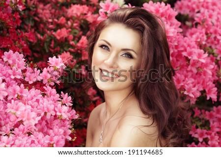 Horizontal portrait. Beautiful female. Model in flowers. Spring seasonal look - stock photo