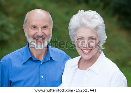 Horizontal portrait of a Caucasian senior couple happy together, wearing casual clothes - stock photo