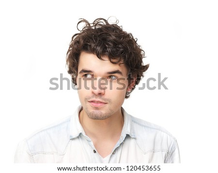 Horizontal portrait of a handsome young man looking to the side - stock photo