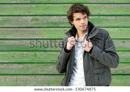 Horizontal portrait of a handsome young man outdoors - stock photo