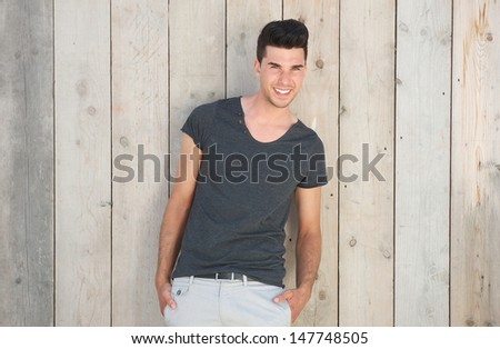 Horizontal portrait of a handsome young man standing outdoors - stock photo