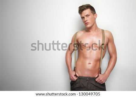 Horizontal portrait of a sexy man undressed - stock photo