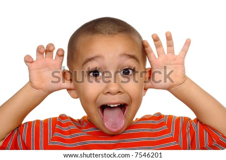 Horizontal portrait of a young boy's silly face - stock photo