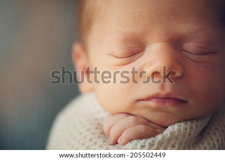 Horizontal portrait of Newborn Baby in cocoon - stock photo