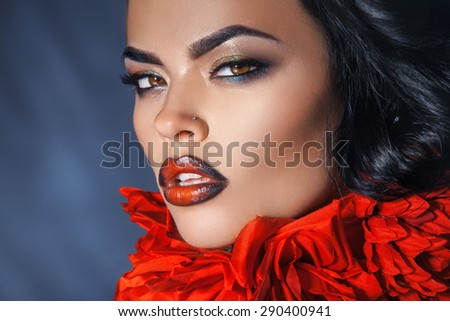 Horizontal portrait of sexy woman with make up and healthy skin in studio - stock photo