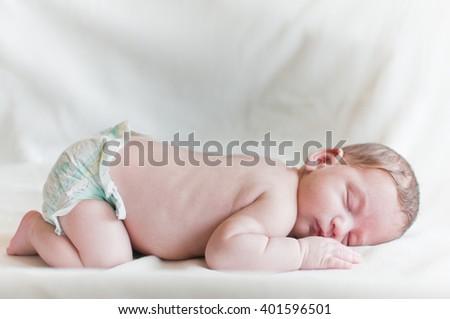 Horizontal portrait of the sleeping baby - stock photo