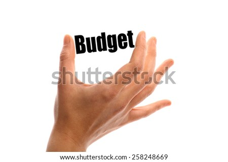 "Horizontal shot of a hand holding the word ""Budget"" between two fingers, isolated on white. - stock photo"