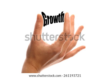 "Horizontal shot of a hand squeezing the word ""Growth"" between two fingers, isolated on white. - stock photo"