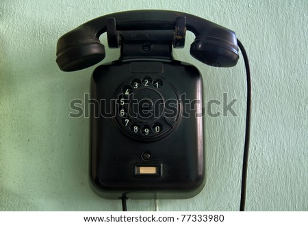 horizontal shot of a vintage wall telephone