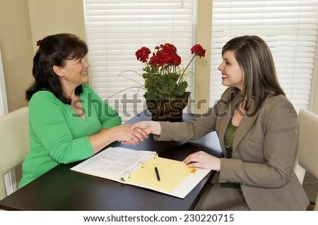 Horizontal Shot Of Businesswoman Shaking Customer's Hand At Meeting - stock photo