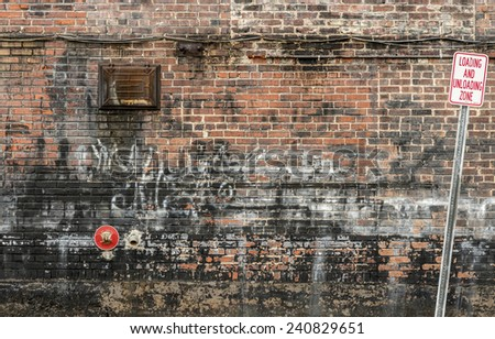 Horizontal Shot Of Cluttered Old Brick Wall Background - stock photo