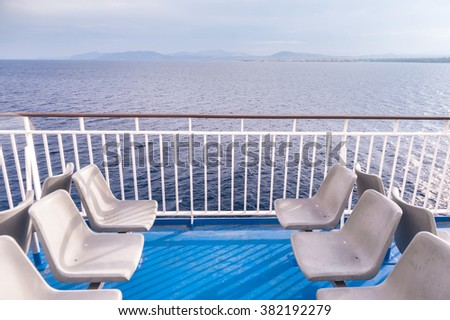 Horizontal shot of empty chairs on one of the greek ferry boats in Rafina, Greece