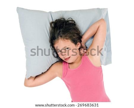 Horizontal Shot Of Little Girl With Head On Pillow And Smiling/ Little Girl Waking Up And Smiling  - stock photo