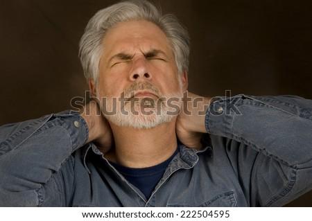 Horizontal Shot Of Man With Stress Headache/ Headache From Stress - stock photo