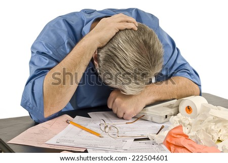 Horizontal Shot Of Man With Tax Troubles/ Tax Time Troubles - stock photo