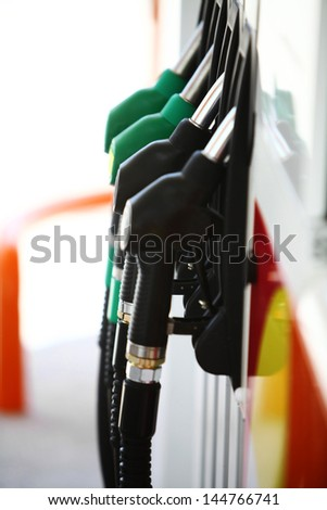 Horizontal shot of some fuel pumps at a gas station - stock photo