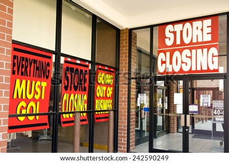 Horizontal Shot Of 'Store Closing' Signs On Building