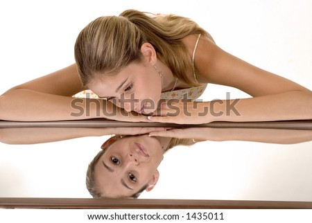 horizontal shot with girl looking at photographer in reflection of mirror - stock photo