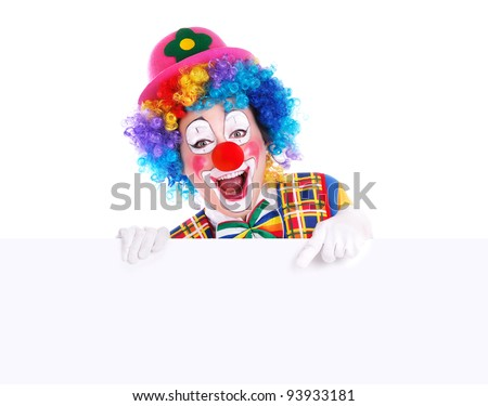 Horizontal studio portrait of a clown pointing to the blank board - stock photo