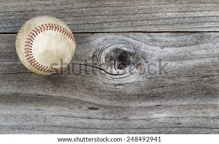 Horizontal top view angle of old baseball on rustic wood  - stock photo