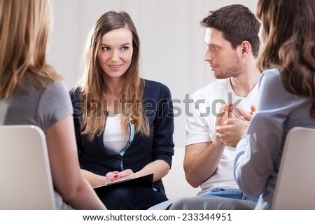 Horizontal view of a meeting during psychotherapy - stock photo