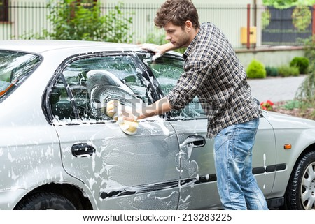 Horizontal view of a professional car cleaning - stock photo