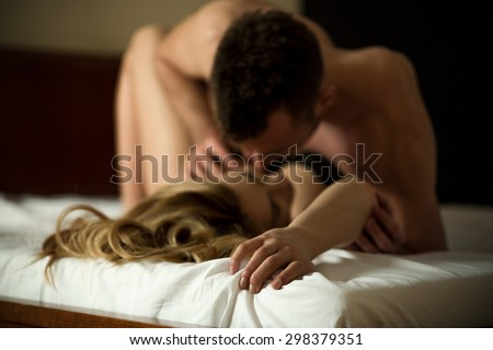 Horizontal view of affectionate couple cultivating sex - stock photo