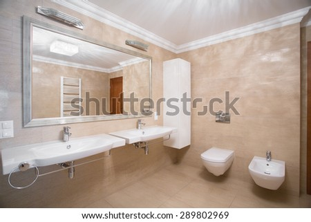 Horizontal view of beige designed toilet interior