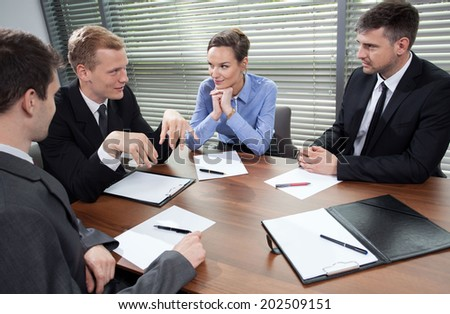 Horizontal view of business meeting in office - stock photo